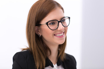 Portrait of a beautiful smiling business woman in glasses