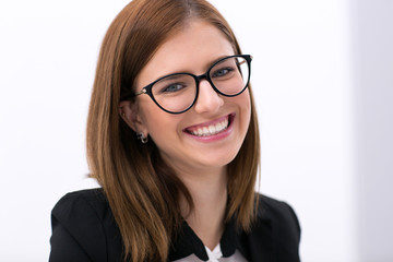 Closeup portrait of a young businesswoman in glasses