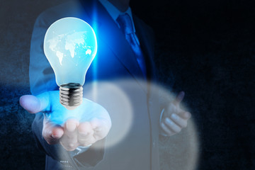 businessman hand showing light bulb with social network structur