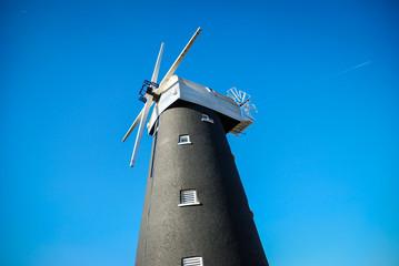 Traditional black brick windmill