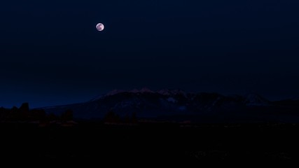Moon Rise over La Sal Mountains Utah - Arches National Park Time