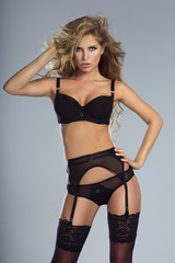 Sexy blonde lady in lingerie.