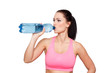 Woman drinking water from bottle isolated