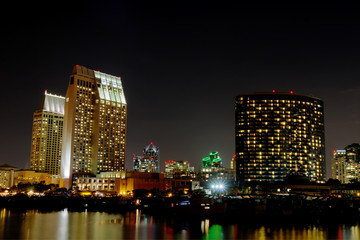 Partial San Diego skyline over water at night