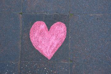Heart drawn in chalk on the sidewalk