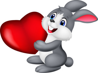 Cute little bunny holds red hart