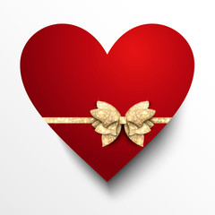 Red paper heart with gold bow