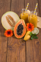 Tropical fruits smoothie on wooden rustic table