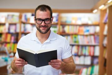 Portrait of a man in a bookstore