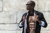 Fototapety African black man model with six pack in black suit