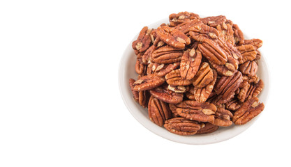 Pecan nut in a white bowl over white background