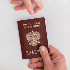 Russian passport in hand on a white background