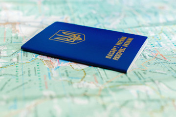 Ukrainian passport on tourist map