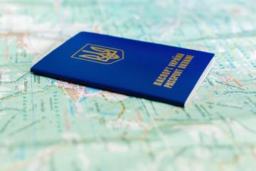 Ukrainian passport on tourist map