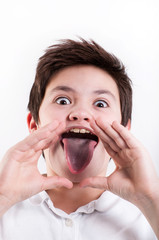 boy showing tongue