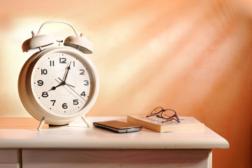 bedside alarm clock and personal belongings