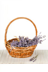 Basket with dry lavender flowers isolated on white