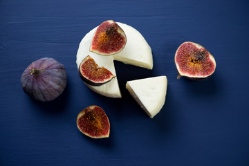 Still life with sliced cheese and figs, studio shot, above view
