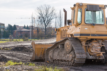 tracked loader excavator at construction area