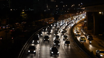 highway busy traffic at night, driving at rush hour
