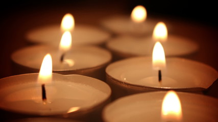 candlelight shivering in the dark