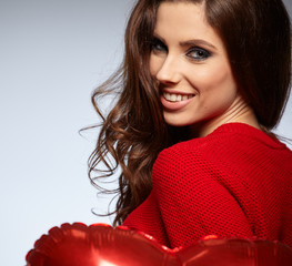 Beautiful woman holding red balloon. Valentines day concept.