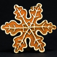white and brown Christmas decoration, snow flake against black b