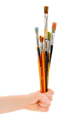 Female (woman) painter hold different paintbrushes