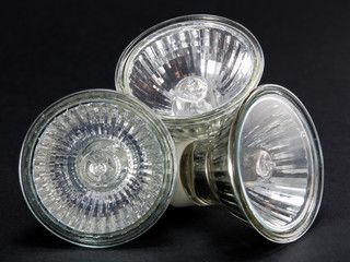 Group of No LED GU10 bulbs, lamps against a black background