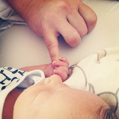First contact newborn touch hand