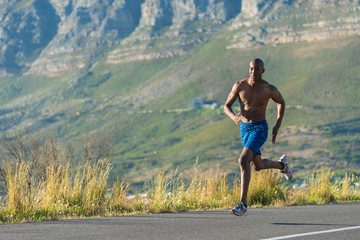 Athletic,  black male running along a road