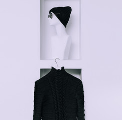 Warm Fashionable Clothing. Trend knit sweater and hat for women.