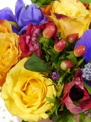 A bouquet with different flowers in bright colors