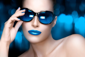 Fashion Model Woman in Blue Oversized Sunglasses. Colorful Makeu