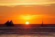 Leinwanddruck Bild - Sailboats at sunset on a tropical sea. Silhouette photo.
