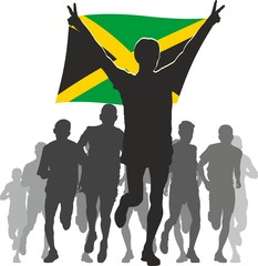 Athlete with the Jamaica flag at the finish