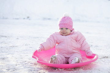 Happy baby girl, winter outdoor