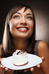 young woman eats a sweet cake