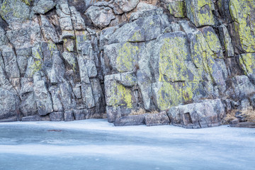 frozen river and rocky cliff