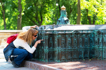 Tourist looks at a miniature copy of the Winter Palace
