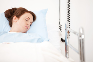 Hospital: Female Patient Asleep in Bed