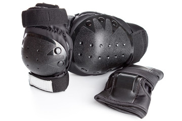 skating protection equipment, knee and wrist protectors, on a wh