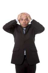 Hispanic businessman in stress and shock hand on head