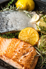 Grilled salmon fish with herbs, garlic and lemon. Healthy seafoo