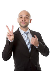 successful businessman making V of Victory sign with fingers