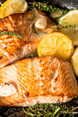 Grilled salmon with herbs, garlic and lemon