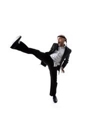 businessman in kung fu kick or karate kick attack