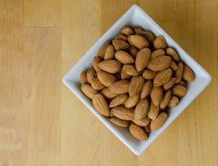Almonds in White Bowl with Copy Space
