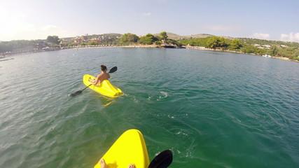 Young people having fun at while kayaking