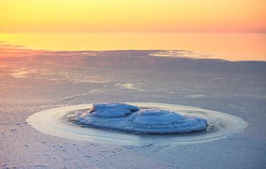 Frozen stone at seashore